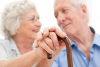 Man holding partners hand after misdiagnosis